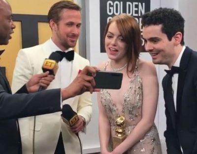 Veja a divertida reação de Emma Stone ao beijo de Andrew Garfield e Ryan Reynolds no Globo de Ouro